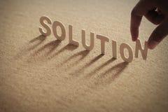 Mot en bois de SOLUTION sur le conseil comprimé Photos libres de droits