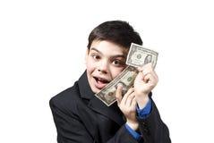 mot glatt monetärt för utmärkelsepojke Arkivfoton