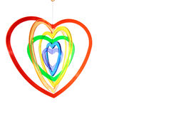 mot hängande hjärta formade sex vita format Royaltyfri Bild