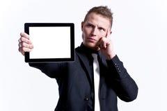 mot hans manlig som presenterar tabletbarn Arkivbild