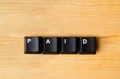 Mot payé Image stock