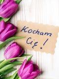 Mot polonais AMOUR et bouquet des tulipes Photos libres de droits