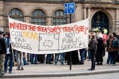 mot protesten uk för bankirkonferenslibdem Arkivfoto