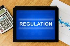 Mot réglementaire sur le comprimé numérique photographie stock