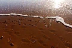 Mot rêveur écrit dans la plage Photos stock