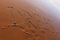 Mot rêveur écrit dans la plage Images libres de droits