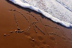 Mot rêveur écrit dans la plage Photographie stock libre de droits