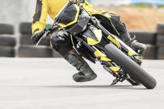 Motard motorcycle in corner on track Stock Photos