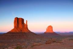 Motas de la puesta del sol en el valle Arizona del monumento Fotografía de archivo