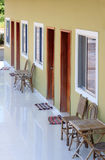 Motel balcony with wooden chairs, tables and mats Royalty Free Stock Photos