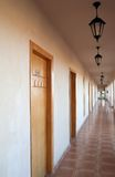 Motel corridor. With many wooden closed doors Royalty Free Stock Images