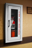 Motel Fire Extinguisher. This motel fire extinguisher is in a recessed wall cabinet Stock Photo