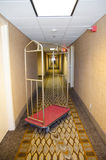 Motel Luggage Cart. A luggage cart in a motel hall Stock Images