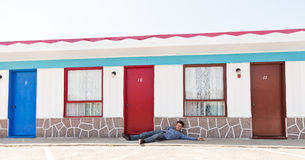 Drunk man at the door Royalty Free Stock Image