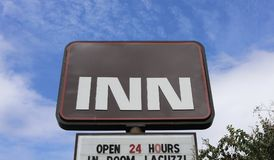 Inn and Suites Motel. A Motel that is open 24 hours a day and offers an in room Jacuzzi Stock Photos