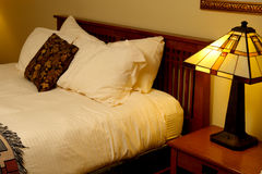 Motel room. Abstract image of the furniture and bedding in a motel room Stock Photos
