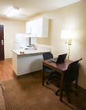 Motel Room Desk and Kitchen Area Hotel Traveler Royalty Free Stock Images