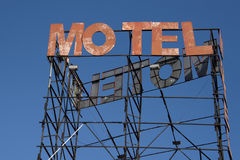 motel rusted sign. Motel rusted sign on blue sky background Royalty Free Stock Photo