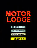 Motel Sign. Motel motor lodge neon sign on the side of the highway Stock Photos