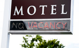 Motel Vacancy Sign. Red neon vacancy sign at a motel stock image