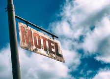 Motel Vintage Rusted Sign. Old rusted sign hanging off the side of an old country road. Motel sign Royalty Free Stock Photos