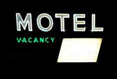 Motel-Zeichen mit Vorstand stockbild