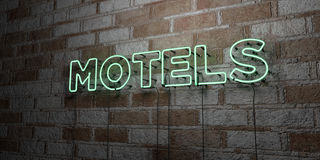 MOTELS - Glowing Neon Sign on stonework wall - 3D rendered royalty free stock illustration Royalty Free Stock Photos