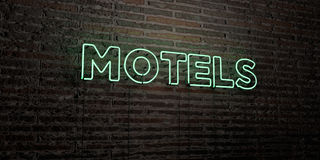 MOTELS -Realistic Neon Sign on Brick Wall background - 3D rendered royalty free stock image Stock Images