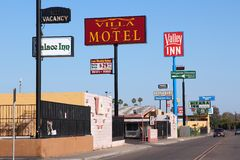 Motels in United States. FRESNO, UNITED STATES - APRIL 12, 2014: Motel row in Fresno, California. There are about 150 motels in Fresno, the 5th largest city in Royalty Free Stock Image
