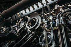 Moteur de moissonneuse, chaînes de vitesse, transmission de mécanismes de nouveau véhicule moderne de cartel de technologie Photo stock