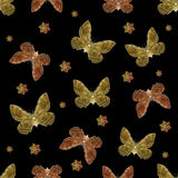 Moth Motif Seamless Pattern Design. Digital photo collage moth motif pattern design in warm colors against black background Stock Photo