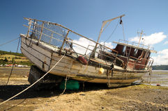Mothballed boat in the coast Royalty Free Stock Photo