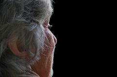 Mother. Beautiful portratit of old lady, natural light makes her face shine with divine light and intensity royalty free stock photo