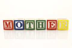 Mother. Word Mother in wooden blocks Stock Photography