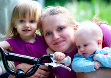 Mother and 2 daughters in Park Stock Photos