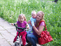 Mother and 2 daughters in Park Royalty Free Stock Image
