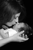 Mother. Beautiful Young Brunette Mother Kissing and Holding Newborn Son Stock Images