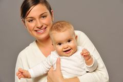 Mother with adorable baby Stock Images