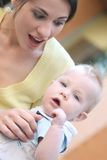 Mother with adorable baby boy - happy family. Happy family - young mother with her adorable baby boy son, suitable for a variety of family, parenting backgrounds Stock Photography