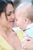 Mother with adorable baby boy - happy family. Happy family - young mother with her adorable baby boy son, suitable for a variety of family, parenting backgrounds Stock Image