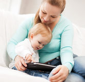 Mother and adorable baby with tablet pc Royalty Free Stock Photo