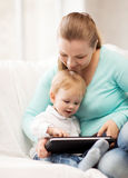 Mother and adorable baby with tablet pc Royalty Free Stock Photos