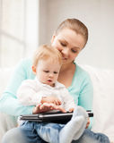 Mother and adorable baby with tablet pc Stock Photos