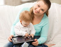 Mother and adorable baby with tablet pc Royalty Free Stock Photography