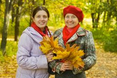 Mother with adult daughter in autumn Royalty Free Stock Image