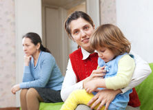Mother and adult daughter with baby after quarrel Stock Image