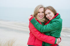Mother and adult daughter embraced by the sea Royalty Free Stock Images