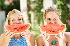 Mother And Adult Daughter Enjoying Water Melon Royalty Free Stock Images
