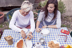 Mother and adult daughter having breakfast Royalty Free Stock Photography