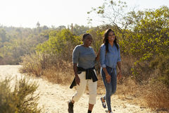 Mother And Adult Daughter Hiking Outdoors In Countryside stock image